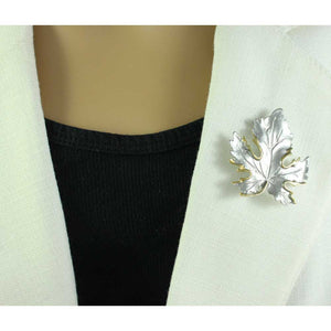 Model with Silver-tone Maple Leaf Edged with Gold Brooch Pin - Lilylin Designs