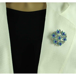 Model with Aqua and Cobalt Blue Crystal Daisies Wreath Flower Brooch Pin - Lilylin Designs
