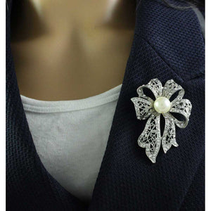 Model with Silver-tone Large Filigree Crystal Bow with Faux White Pearl Brooch Pin - Lilylin Designs