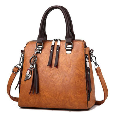 Superior Leather Tassel Cat Pendant Handbag