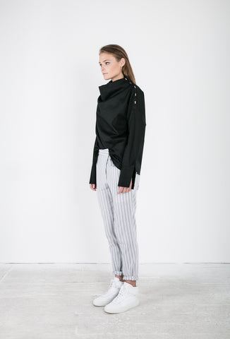 OSKAR black funnel neck long-sleeved shirt and striped pants with tie