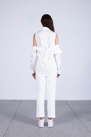 OSKAR white double layered off-shoulder shirt and white skinny leg trousers with split