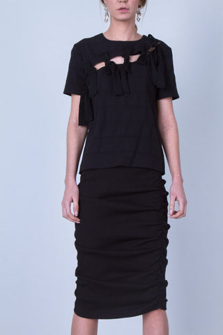 10 Spring Australian Fashion Styles That Embody Playful Minimalism  - oskar tassles cut out tee
