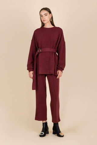 Falsely Accused Textured Elastic Trousers in Burgundy
