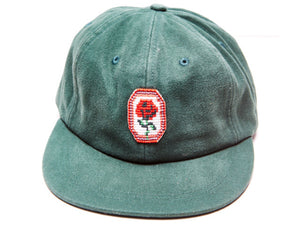 Green Cool Rancher cap with rose pendant