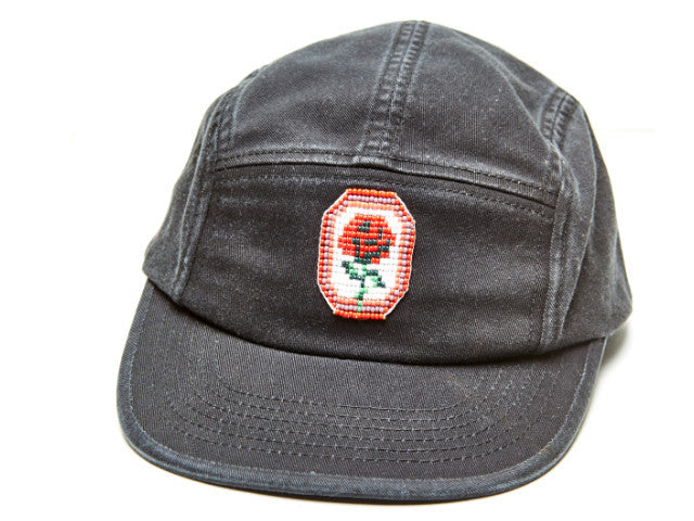 Camp leader cap with rose pendant