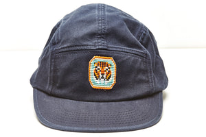 camp leader cap navy blue with tiger pendant close