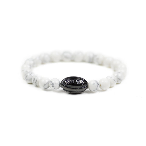 White Howlite w/ Black Rugby Ball