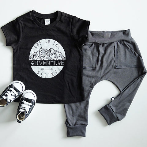 """And so the adventure begins"" Black Child T-Shirt"
