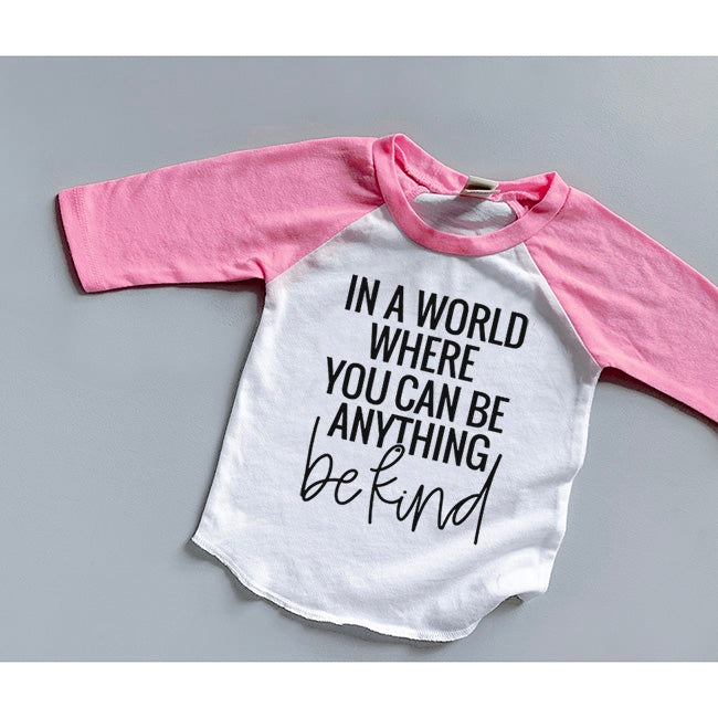 """In a world where you can be anything be kind"" Child Pink and White Raglan - Size 2"
