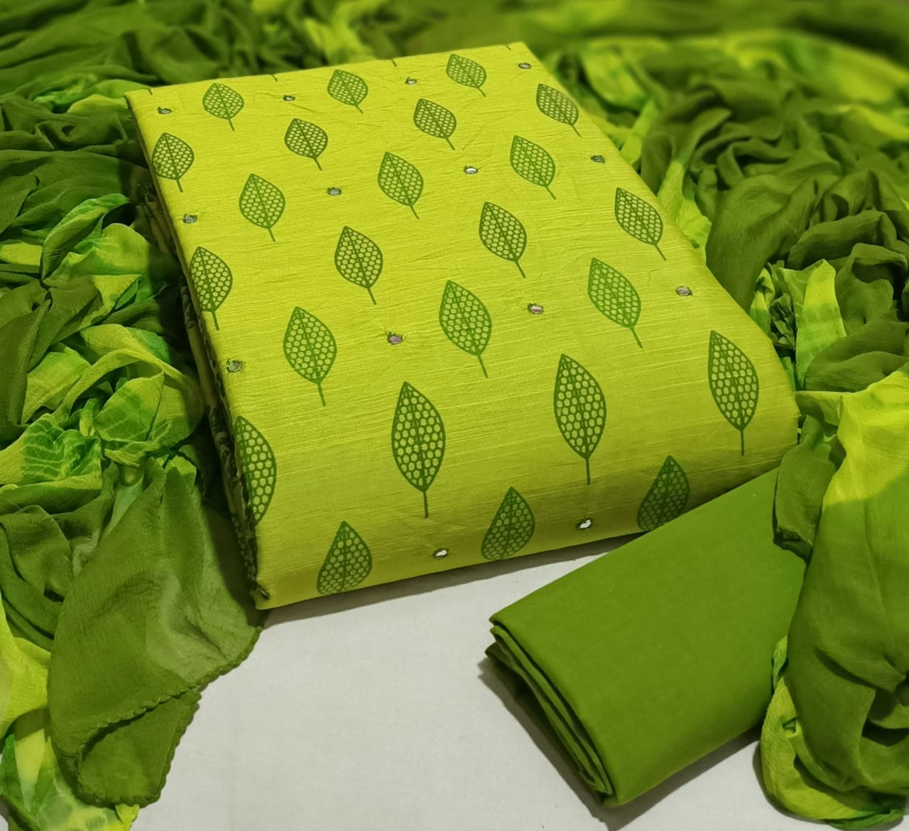Green colour Unstitched Dress Materials for Regular Use
