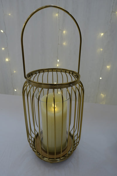Gold cylindrical candle holder