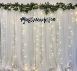 White tulle backdrop with fairy lights