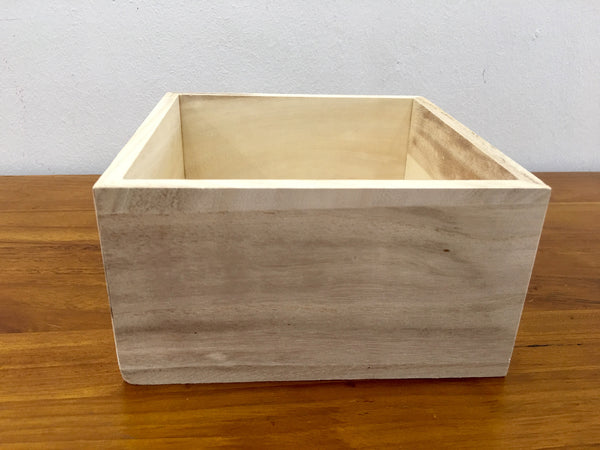 Small light wooden square crate