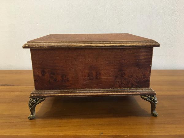Wooden box with gold legs