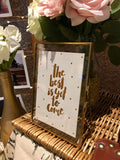 Gold rimmed photo frames