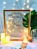 Wooden and white frame welcome signage with customised words