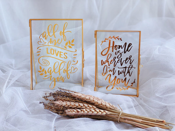 Gold rimmed frames with love quote