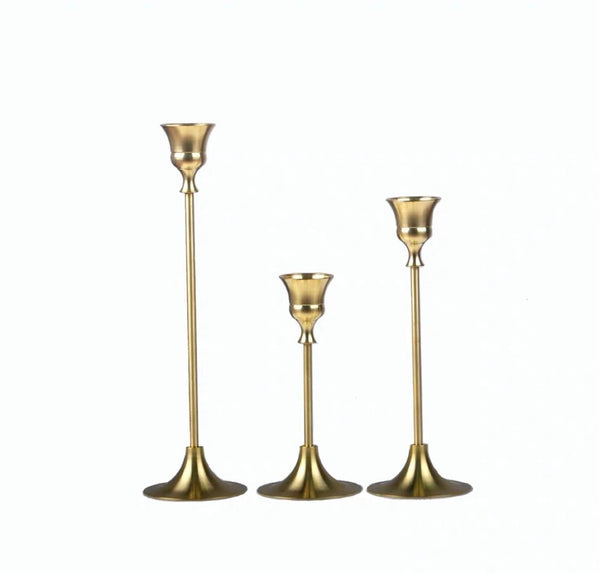 Gold vintage candle stands with white candles