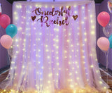 Blush and white tulle backdrop with fairy lights