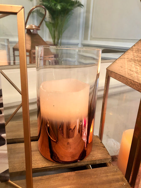 Rose gold cylindrical candle holders