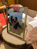 Rose gold rimmed photo frames