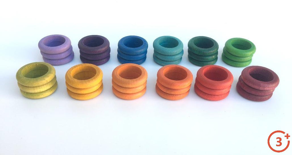 12 stacks of three rings - maroon, red, orange, light orange, yellow, yellow-green, green, evergreen, teal, purple, and lilac.