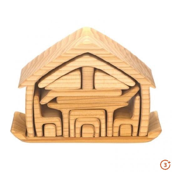 natural colour nesting house. 17 wooden shapes nestled into a larger house shape includes chair pieces, table, and multifunctional shapes for open ended play