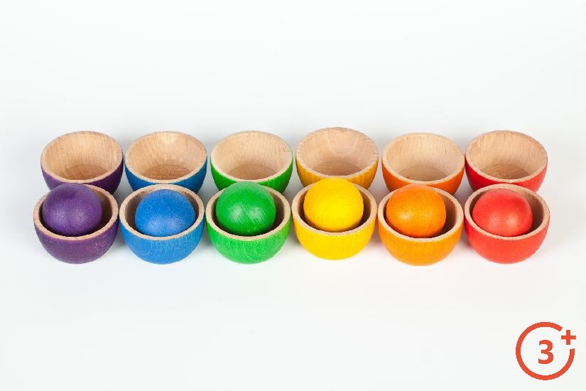 Grapat 12 wooden bowls and 6 matching rainbow coloured balls. 2 bowls of each colour (Red, Orange, Yellow, Green, Blue and Purple) Ball fits inside bowl