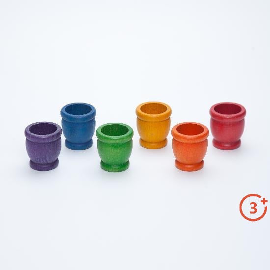 wooden cups in red, orange, yellow, green, blue and purple.