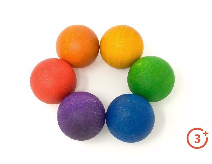 6 wooden balls in rainbow bright colours. Red, Orange, Yellow, Green, Blue, and Purple.