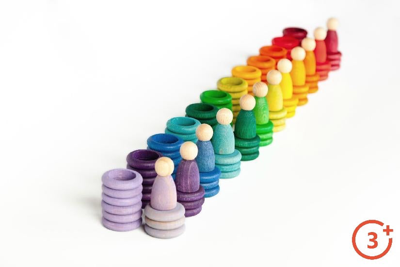 picture of 12 colours of rings, coins and Nins (peg people). Maroon, Red, Orange, Light Orange, Yellow, Yellow-green, green, evergreen, teal, navy, purple, and lilac.