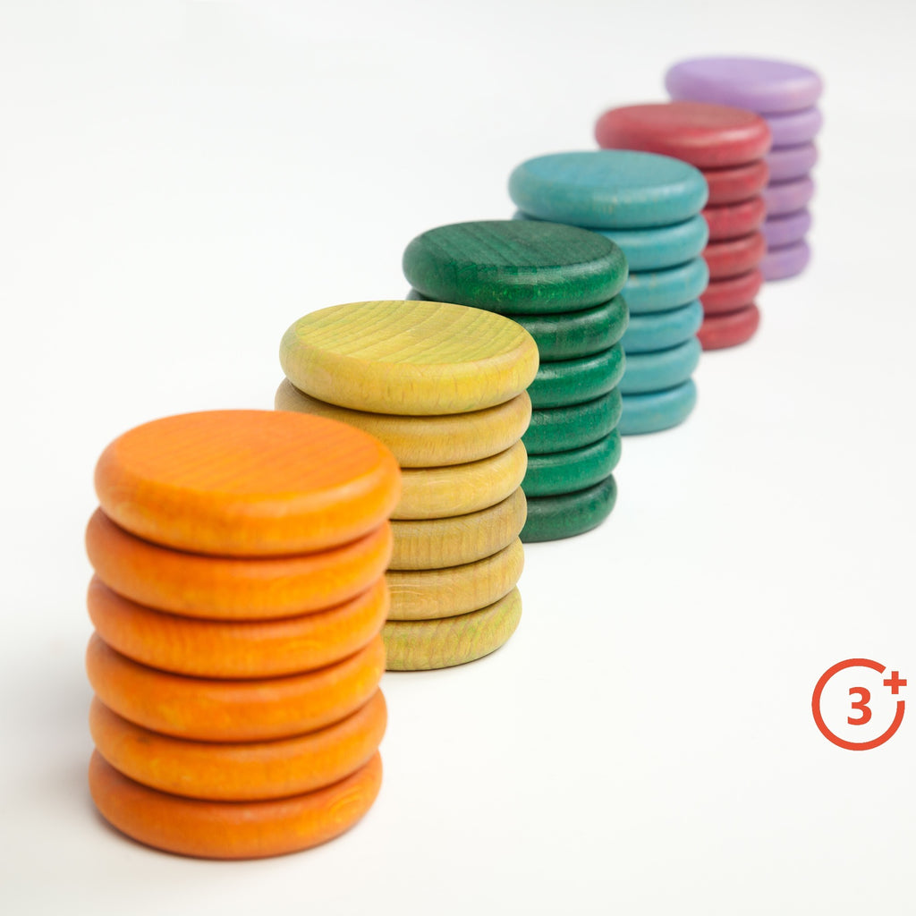6 piles of 6 coins in 6 different colours. Dark orange, Yellow-green, Evergreen, Teal, Maroon, and Lilac.