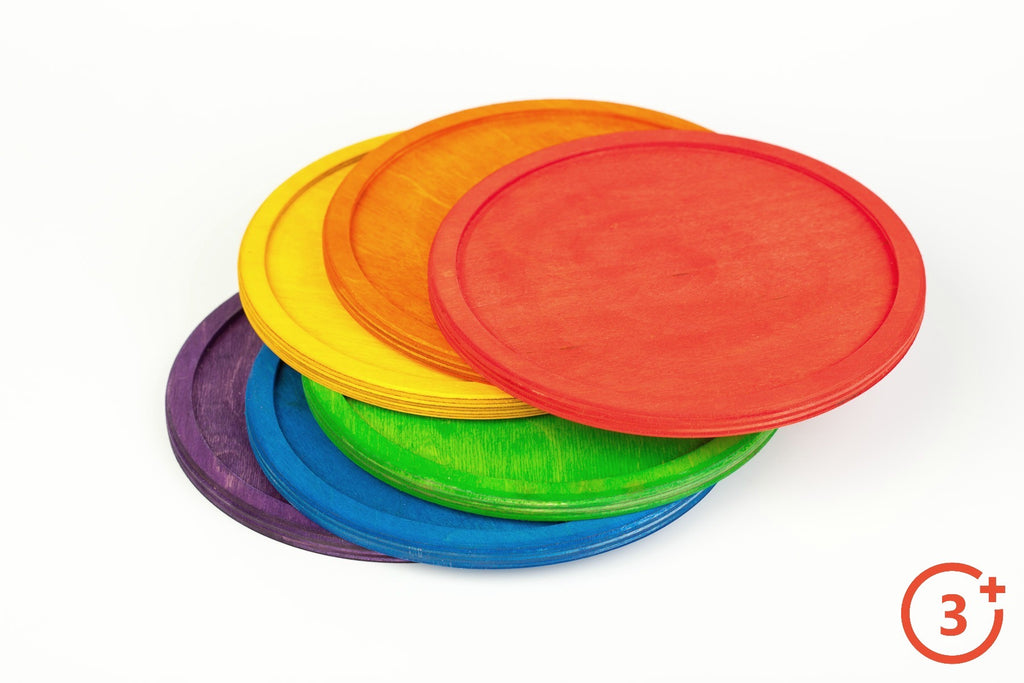 6 wooden plates with rims in rainbow colours - red, orange, yellow, green, blue and purple.