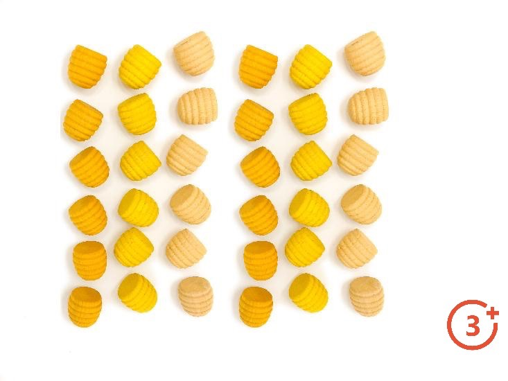 36 yellow honeycomb style wood pieces in shades of dark, medium, and light yellow