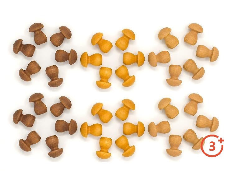 wooden mushrooms in three shades - brown, mustard and beige.