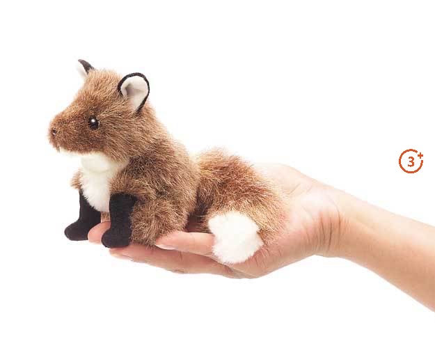 Folkmanis Mini Fox Finger Puppet sitting in palm of models hand. Light reddish brown hair black paws.