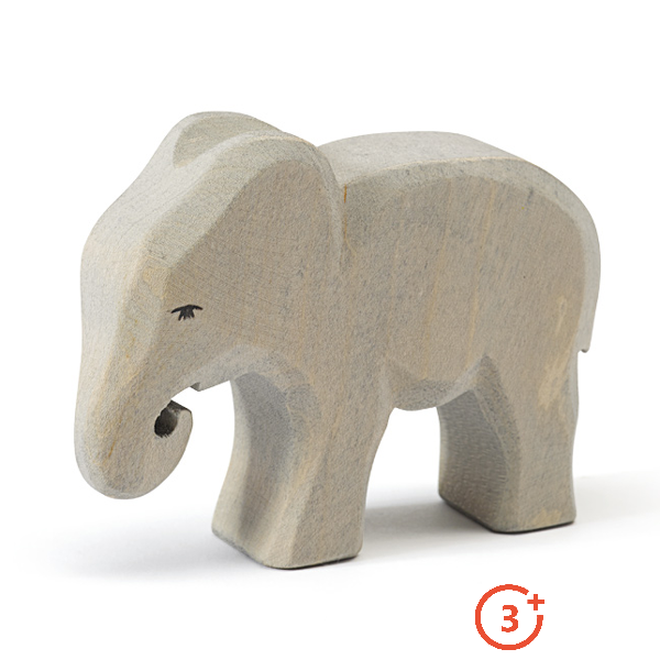 small elephant light grey trunk curled and looking forward. Black eye details.