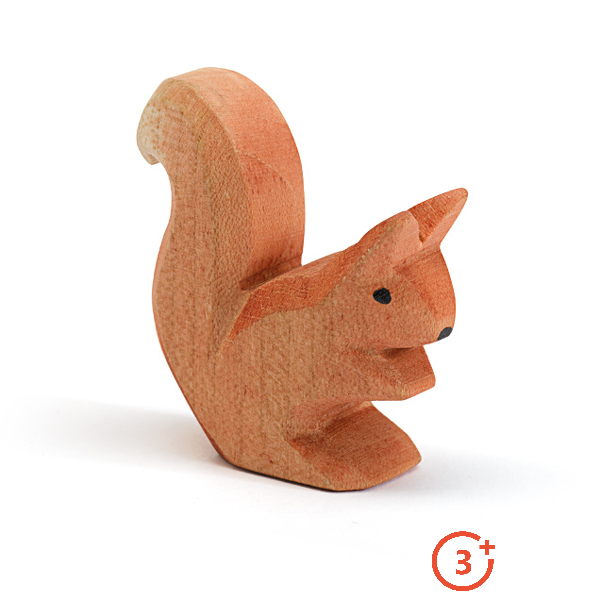 Orange squirrel sitting with hands towards mouth with black detailing for eyes and nose.