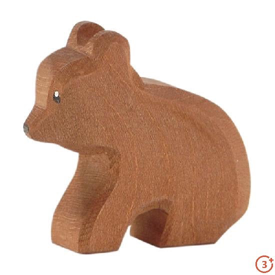 small medium brown baby bear sitting