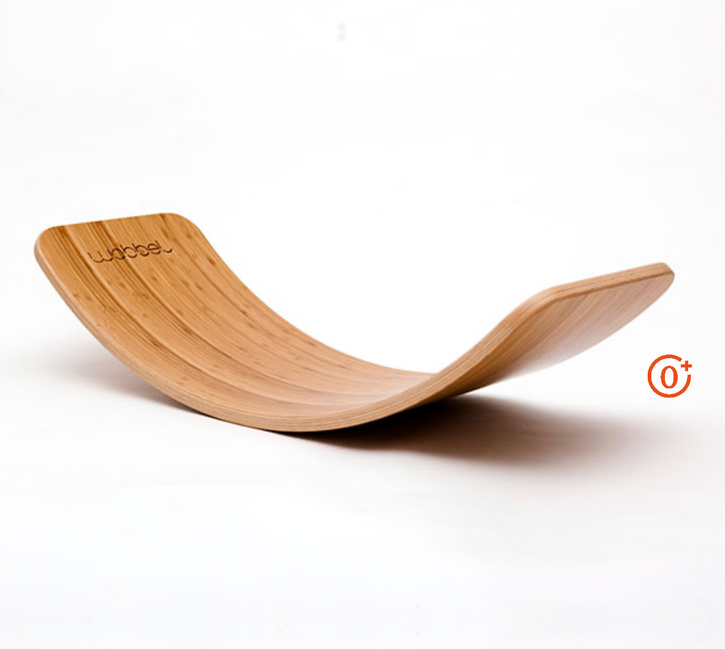 bamboo coloured curved Wobbel Waldorf style board for play, exercise, and lounging