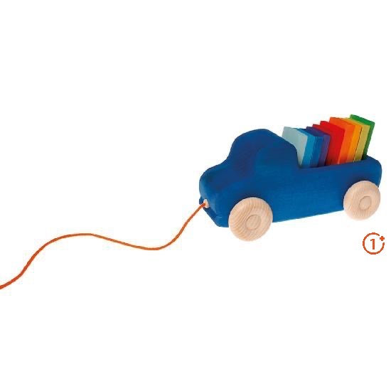 blue wooden truck with thin tablet blocks in bed of truck in rainbow colours