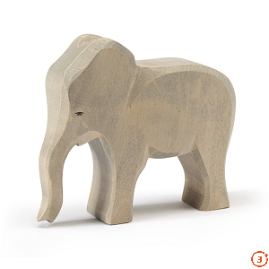 light grey elephant standing trunk down head looking straight