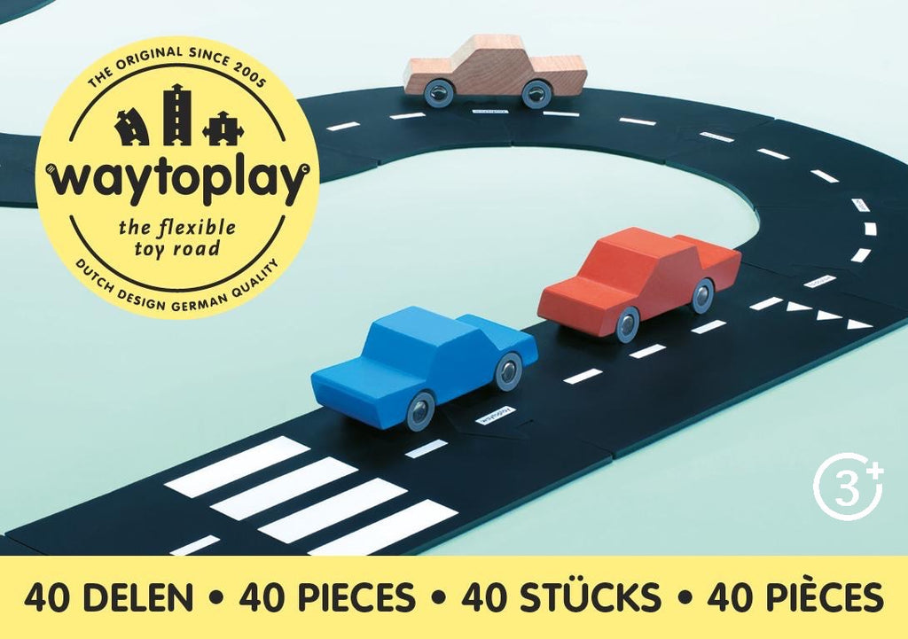 way to play 40 piece set - three wooden cars on way to play rubber road pieces stopped at crosswalk are pictured