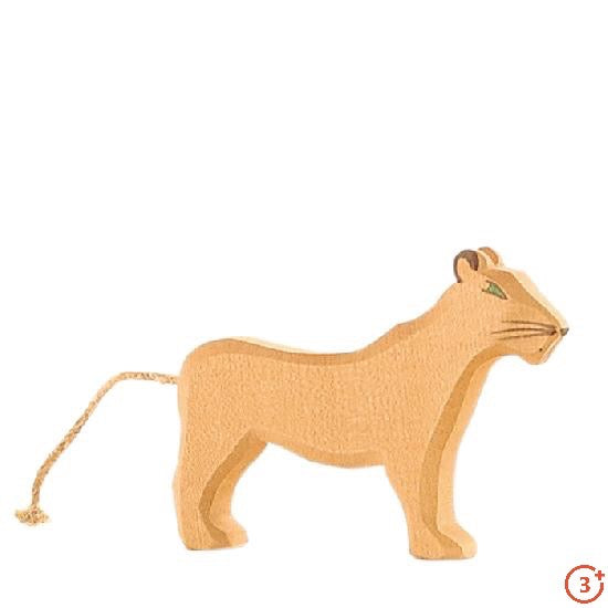 golden colour lioness with rope tale and green eyes. Medium dark brown details for ears whiskers nose and mouth.