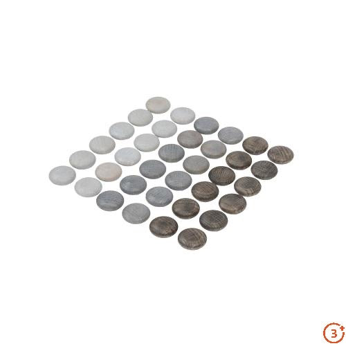 Small wooden grey stones in three different shade of grey from dark to light.