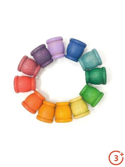 12 wooden mates/cups in the rainbow of colours. Maroon, red, orange, light orange, yellow, yellow-green, green, evergreen, teal, navy, lilac and purple.