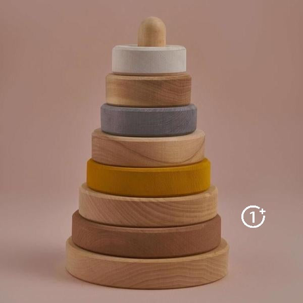 natural wood base, 8 rings alternating between natural wood finish and stain. Colours include warm brown, mustard yellow, mousey grey and white.