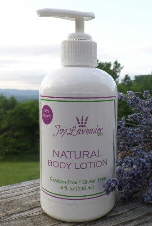 8 oz. White Plastic bottle with pump lid filled with lavender body lotion.