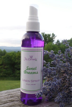 4 oz. Clear purple plastic bottle with white fine mist sprayer filled with clear lavender linen/body spray.